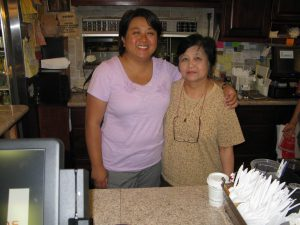 Bennie and her daughter Am behind the counter at Bennie's Thai Cafe